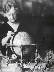 Evangeline Adams (American Astrologer) explores a map